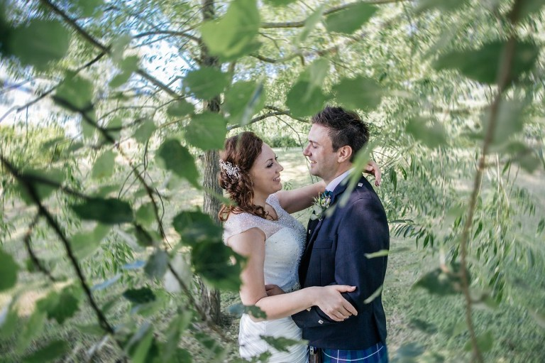 Bride and groom in the grounds of Coltsford Mill