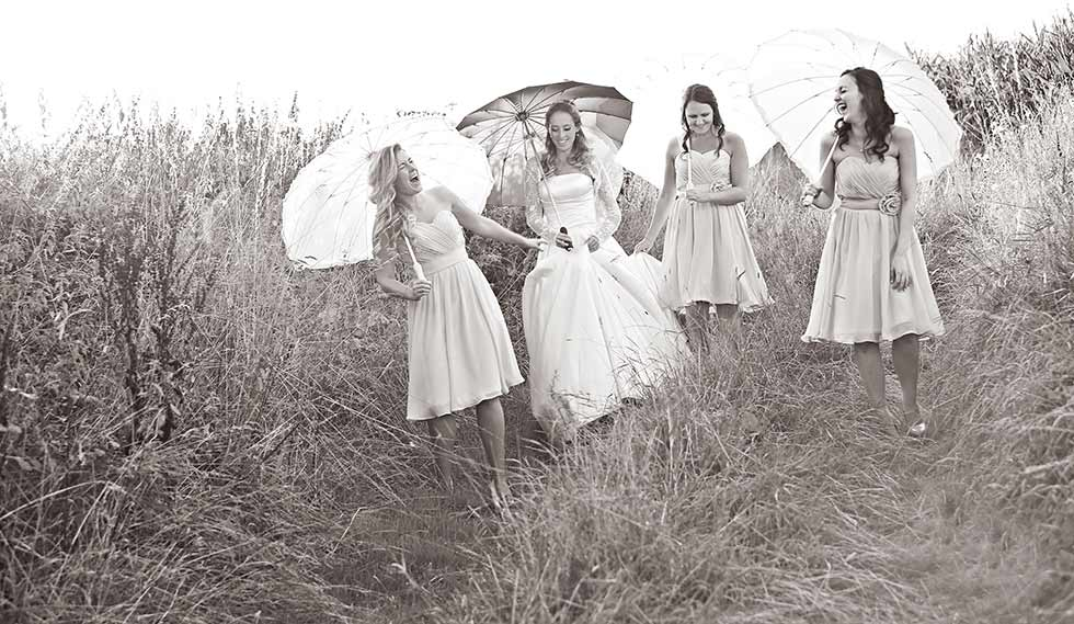 bridal party in field during grittenham barn wedding