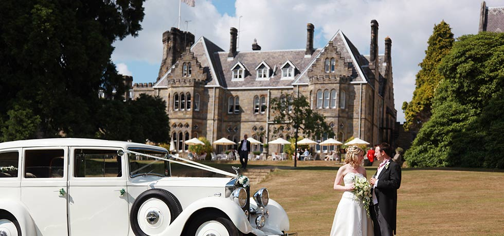 bride and groom outside at ashdown park wedding