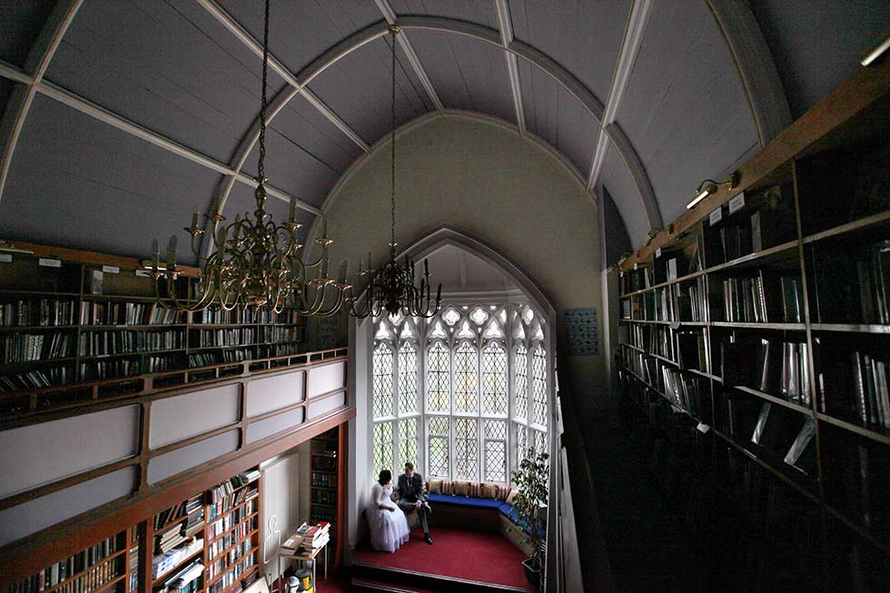 bride and groom in Brighton College library
