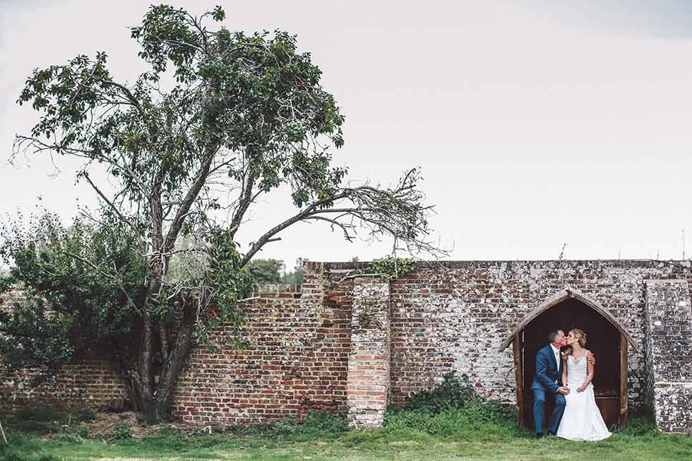 bride and groom kiss at broyle place wedding