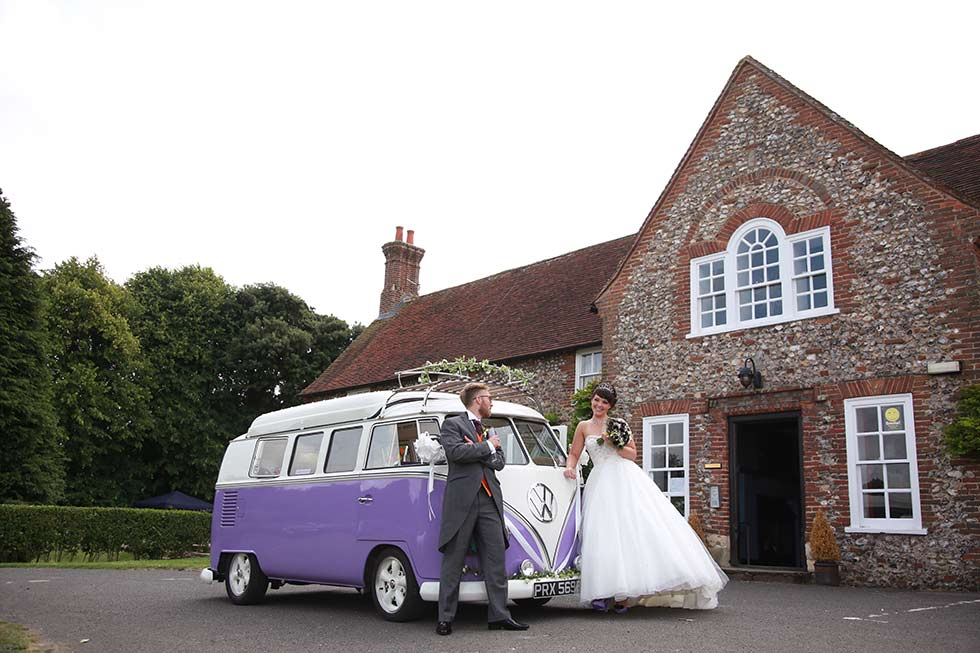 bride and groom and their camper van outside northease manor