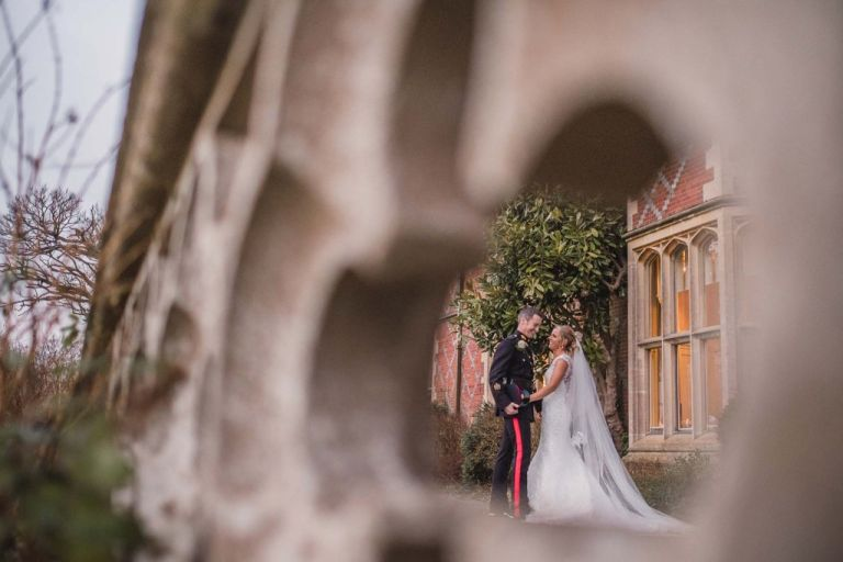 Couple hold hands at on the patio during their Horsted Place Hotel wedding