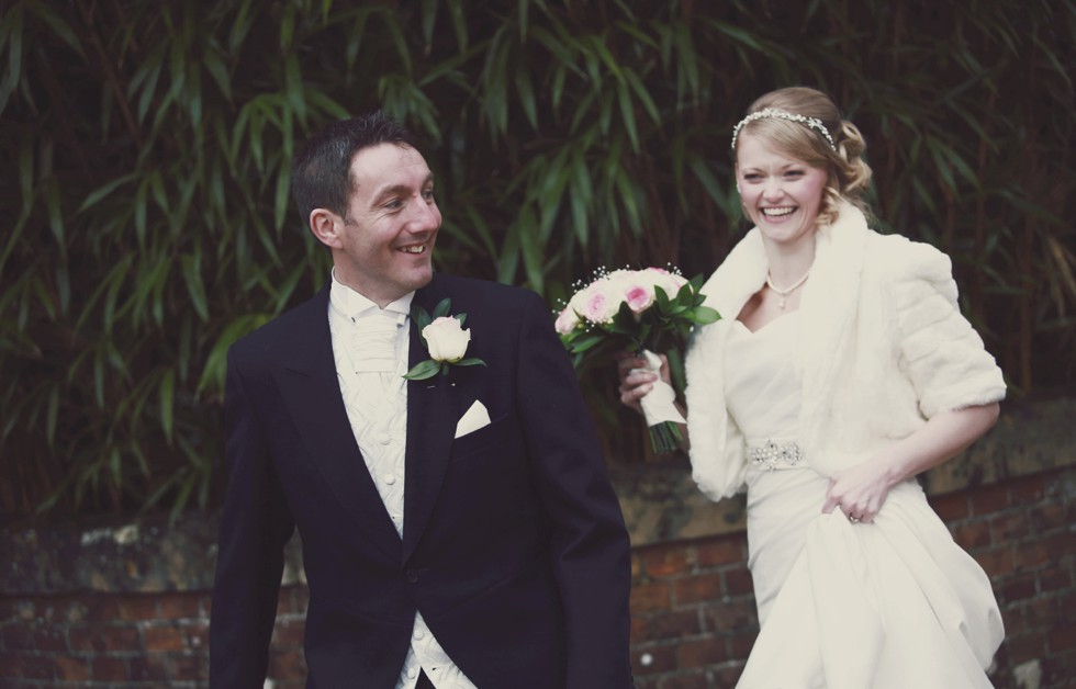 wedding couple laughing in the grounds of Alexander House Hotel