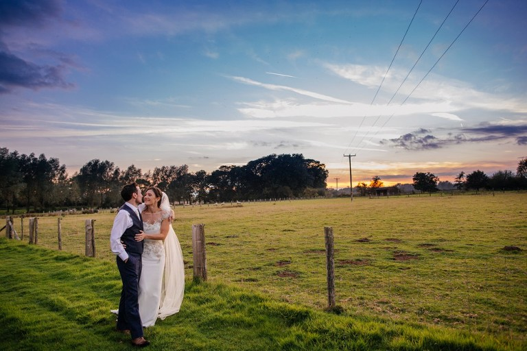 Wedding couple in field at Broyle Place