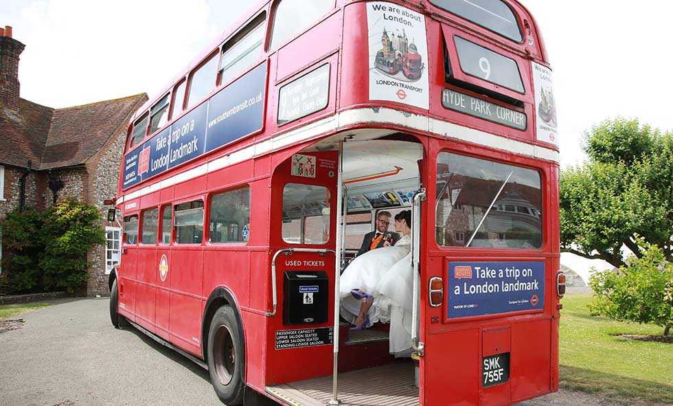 bride and groom on Routemaster bus at Northease manor wedding