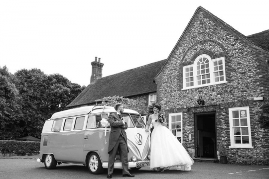 Bride and groom with their camper van at Northease Manor wedding