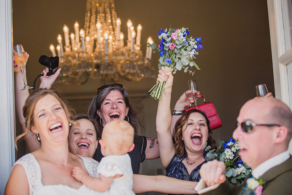 Bridesmaids surprise the happy couple at Buxted Park