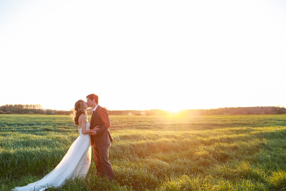 Wedding couple backlit at dusk at Grittenham Barn