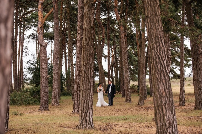 wedding couple in pine clump new forest
