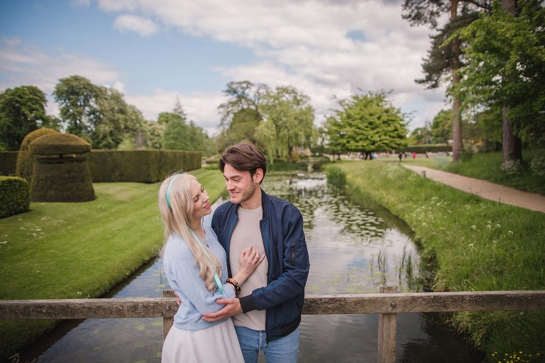 couple on moat bridge during pre-wedding shoot at Hever Castle