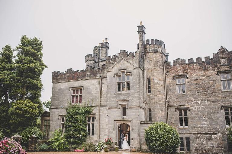 Wedding couple in the doorway of wadhurst castle