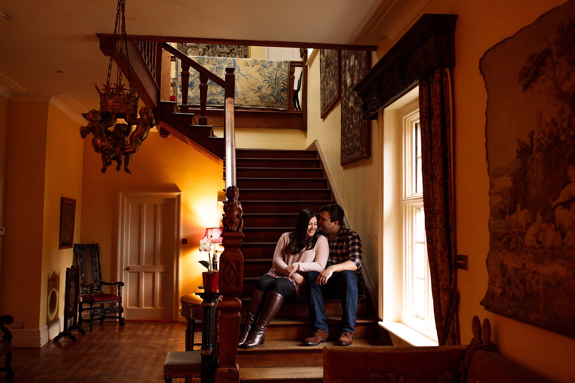 couple sitting on stairs at Wadhurst Castle