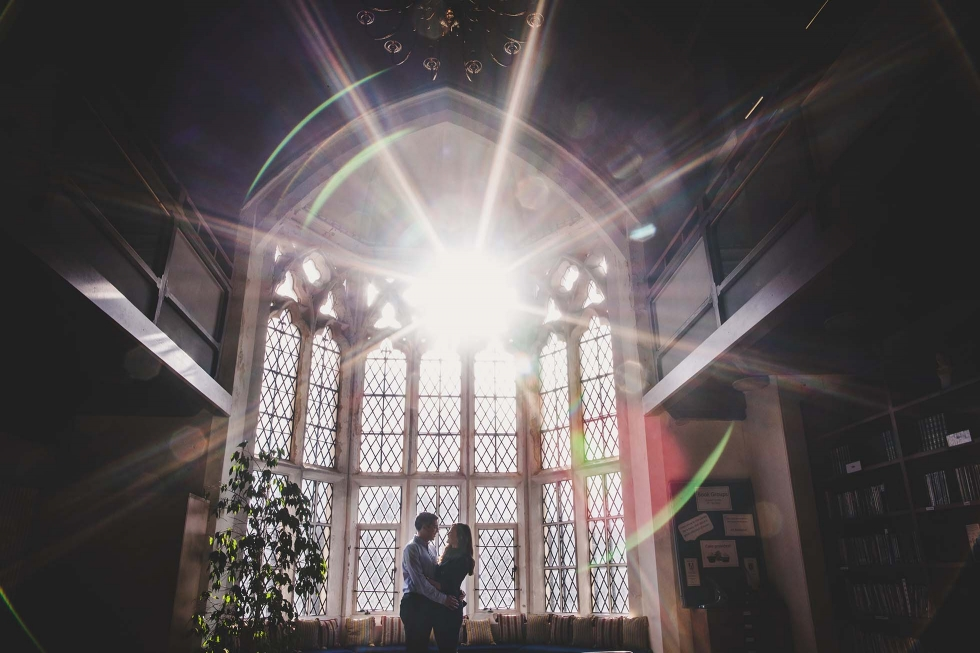 Couple on their pre-wedding shoot in Brighton College library