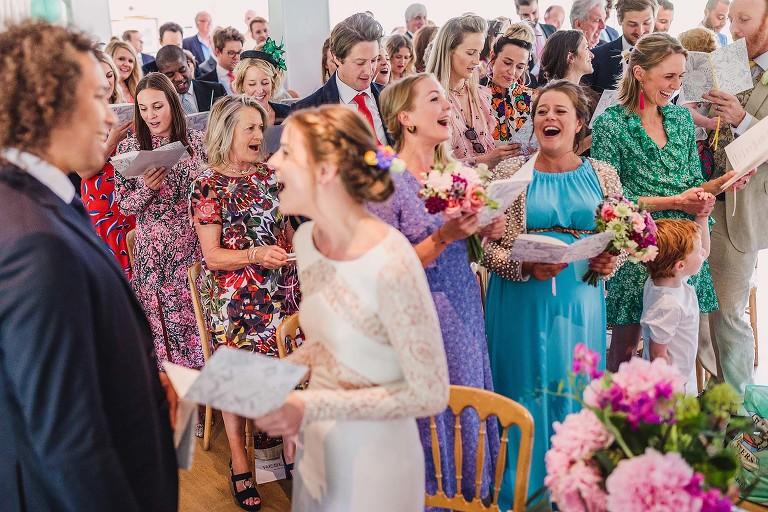 Colourful wedding ceremony singing at Ham Polo Club