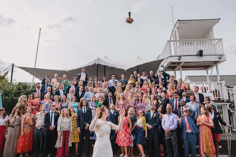 Bouquet toss to all the wedding guests at Ham Polo Club