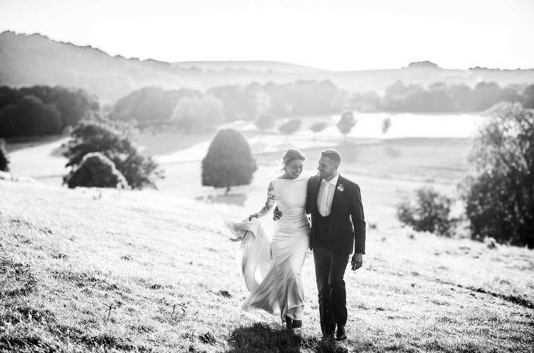 Wedding couple at golden hour in the fields at Cissbury Barns