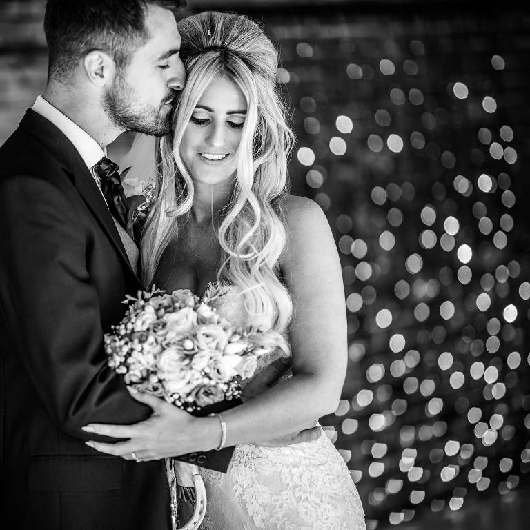 bride and groom tender moment at Winters Barns