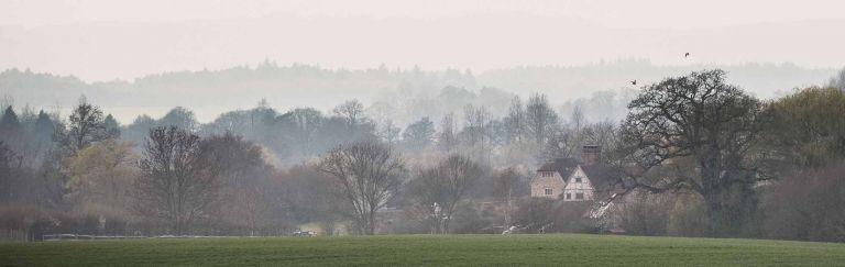 Grittenham Barn wedding venue in amongst the landscape, shot from across the fields