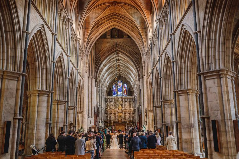 Wide rear view of a Southwark Cathedral wedding ceremony