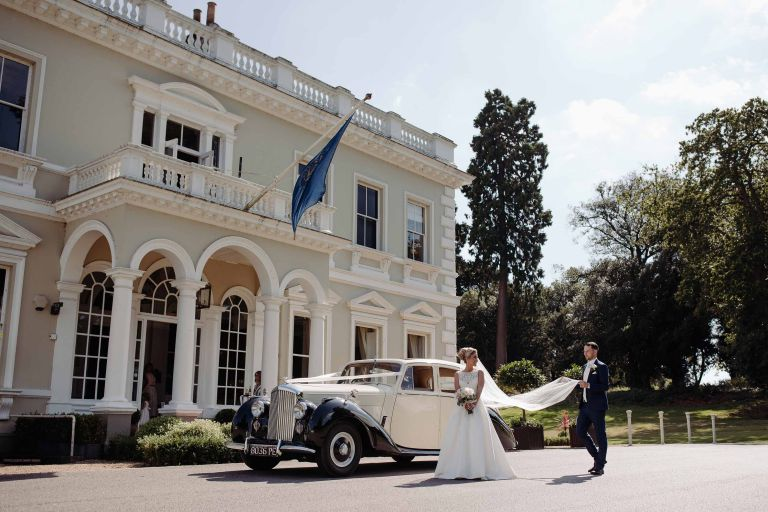 Bride and groom arrive at Burhill Golf Club