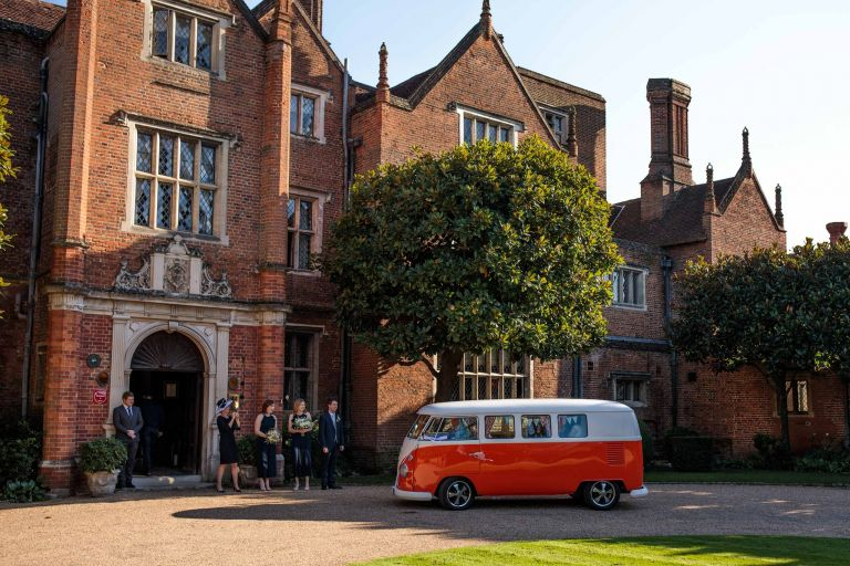 Vintage VW Camper Van delivers the bride at a Great Fosters wedding