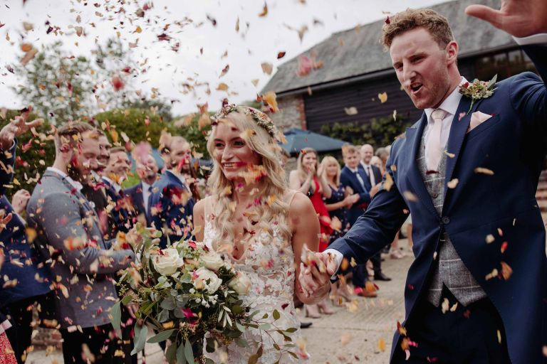 Bride and groom confetti shot at Upwaltham Barns
