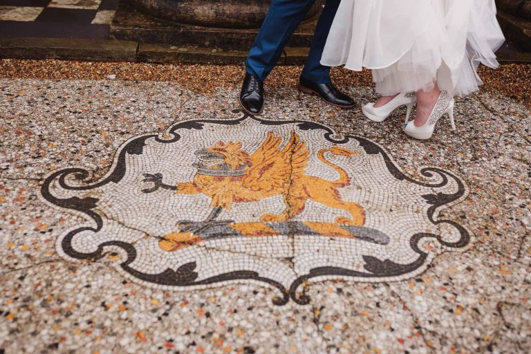 Bride and groom's legs by the Watton House Mosaic