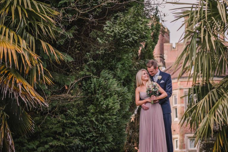 Bride and groom embrace in the gardens at Alexander House Hotel and Spa