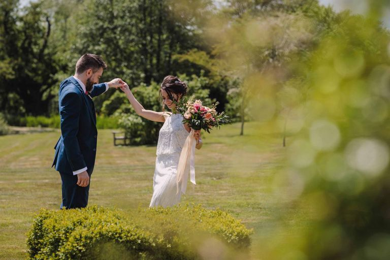 Bride and groom dance in the gardens at Grittenham Barn