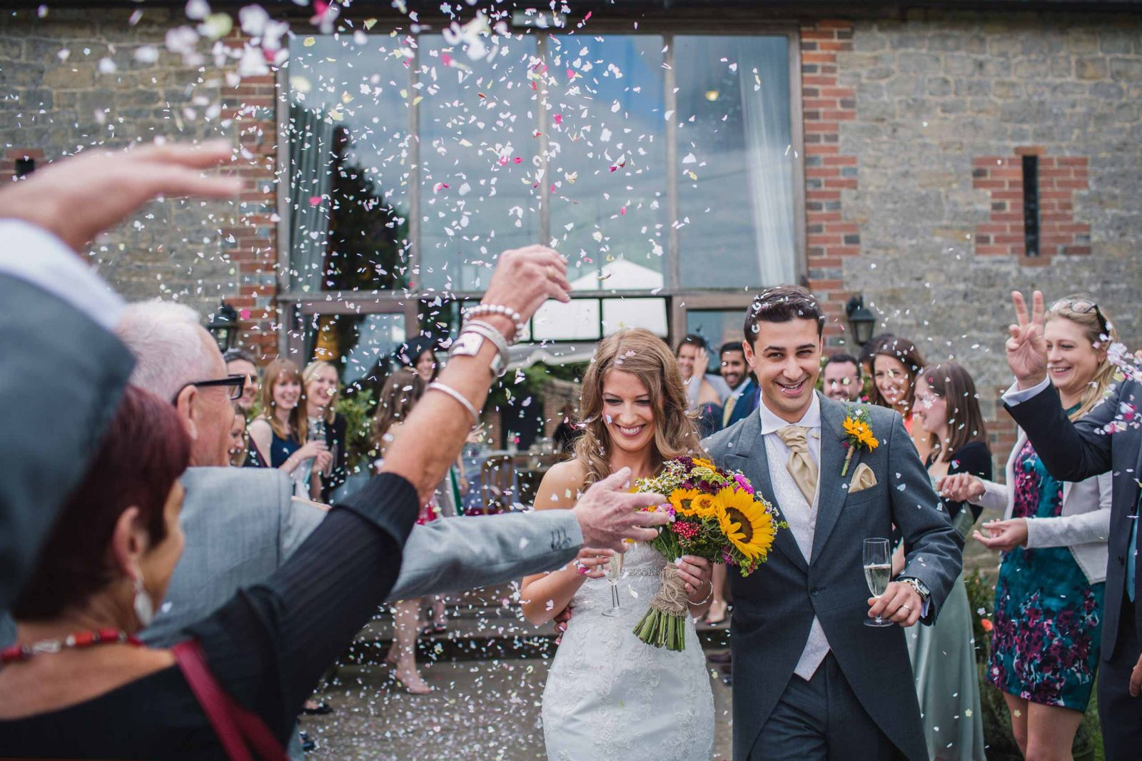 Bride and groom confetti shower at Bartholomew Barn