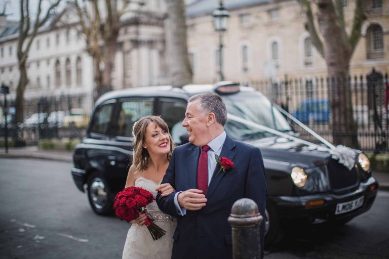 Bride and father of the bride arrive at their Greenwich wedding