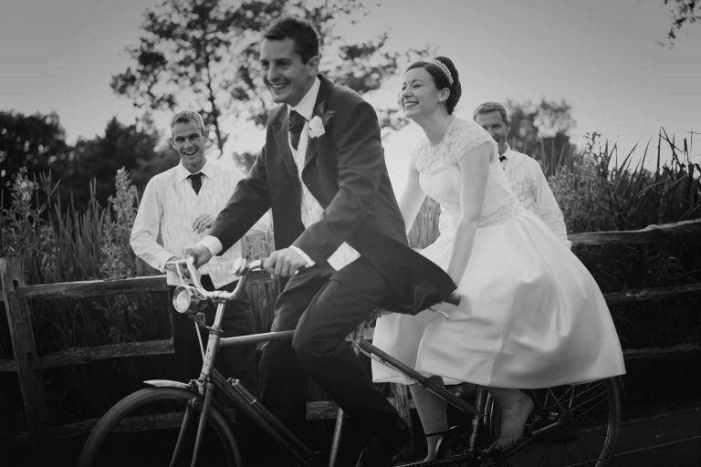 50's bride and groom on a tandem at their coltsford mill wedding