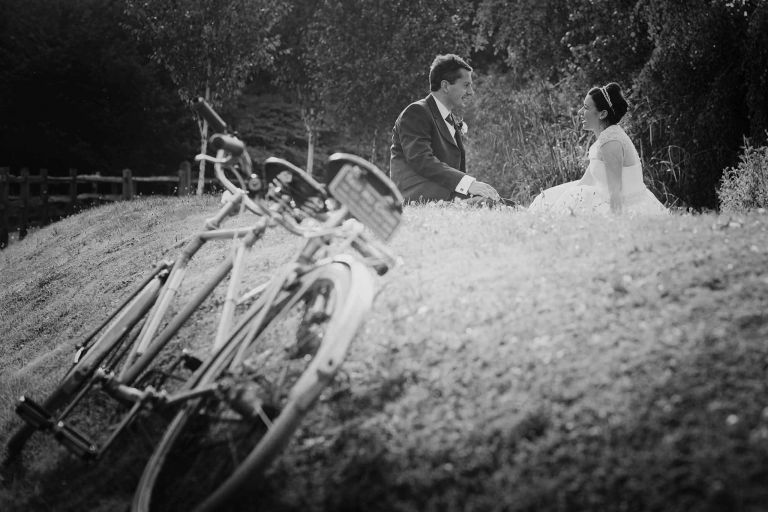 50's bride and groom with a tandem at their coltsford mill wedding