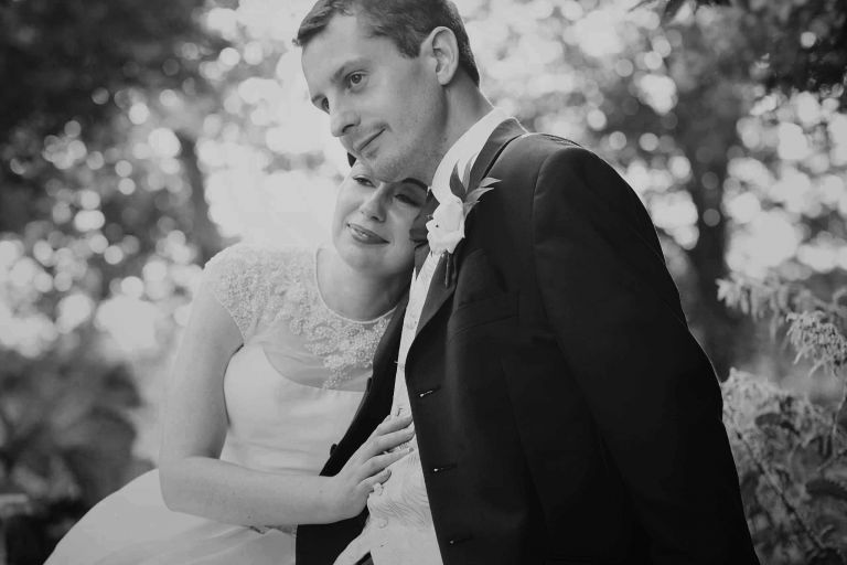 50's bride and groom sitting enjoying the views together at their coltsford mill wedding