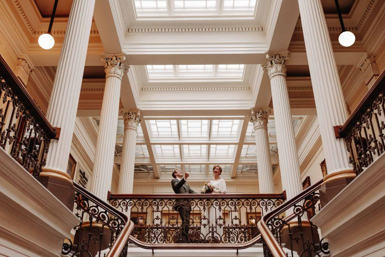 Bride and groom celebrate inside Brighton Town Hall by council chambers
