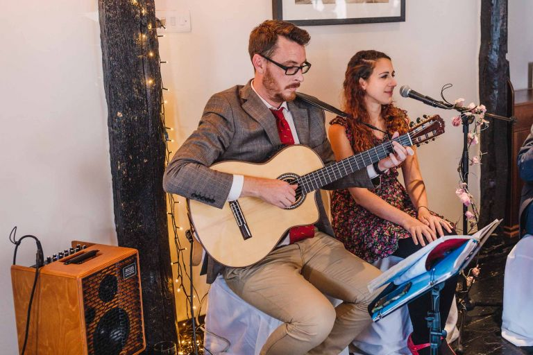 D & L Acoustic Duo singing and playing guitar at an Alfriston wedding